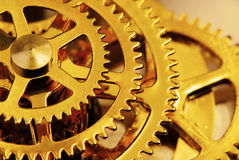 Golden gears Stock Images