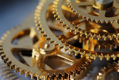 Golden gears. Macro detail of an old clock Stock Photos