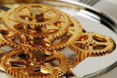 Golden gears. Macro detail of an old clock Royalty Free Stock Image