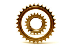 Golden gears forming two concentric circles Royalty Free Stock Photos
