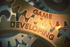 Golden Gears with Game Developing Concept. 3D Illustration. Royalty Free Stock Photography