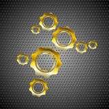 Golden gears on perforated metal background Royalty Free Stock Image