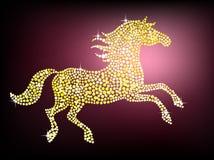 Golden gem horse. Shiny golden horse on a dark purple background Royalty Free Stock Images
