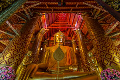 Golden giant buddha. Luang Pho Tho houses an immense seated gilded Buddha which was made in 1334 CE. The statue is 19 meters high stock photo
