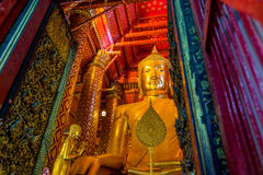 Golden giant buddha. Luang Pho Tho houses an immense seated gilded Buddha which was made in 1334 CE. The statue is 19 meters high royalty free stock images