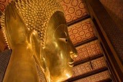 The Golden Giant Reclining Buddha (Sleep Buddha) in Wat Pho Temple, Bangkok, Thailand. The Giant Golden Reclining Buddha (Sleep Buddha) in Wat Phra Chetuphon royalty free stock photos