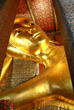 The Golden Giant Reclining Buddha (Sleep Buddha) in Wat Pho Temple, Bangkok, Thailand. The Giant Golden Reclining Buddha (Sleep Buddha) in Wat Phra Chetuphon royalty free stock photo