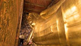 The Golden Giant Reclining Buddha in Wat Pho Buddhist Temple, Bangkok, Thailand Stock Photo