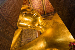 The Golden Giant Reclining Buddha in Wat Pho Buddhist Temple, Bangkok, Thailand Royalty Free Stock Image