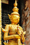 The golden giant statue in Wat Phra Kaew Stock Images
