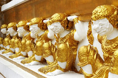 Golden giants  on the base wall  pagoda Stock Photography