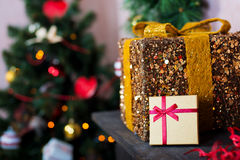 Golden gift on the background Royalty Free Stock Image