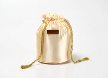 Golden Gift Bag. Golden Giftbag with a nameboard on a white background Royalty Free Stock Image