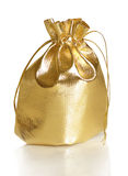 Golden gift bag. Isolated on a white background royalty free stock photo