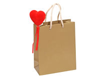 Golden gift bag with red heart. Stock Images