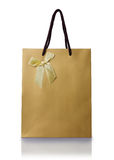 Golden gift bag with ribbon bow Royalty Free Stock Photo