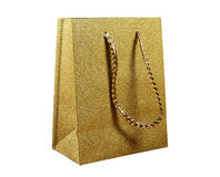Golden gift bag on a white background Stock Photo