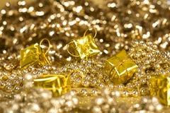 Golden gift. Gift, golden bow, red bow, glitter Stock Image