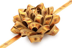 Golden gift bow with ribbon. Royalty Free Stock Photo