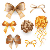 Golden gift bows Royalty Free Stock Images