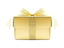 Golden gift box. With golden ribbon on white background stock photography