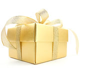 Golden gift box. With golden ribbon on white background royalty free stock images