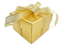 Golden gift box. With golden ribbon on white background stock images
