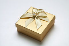 Golden gift box. A golden gift box on a white background Stock Photo