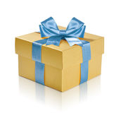 Golden gift box. With blue ribbon over white background. Clipping path included Royalty Free Stock Photo
