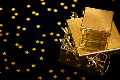 Golden gift box on black background Royalty Free Stock Photo