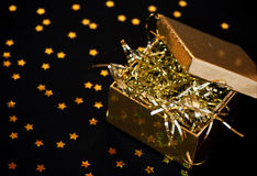 Golden gift box on black background Stock Photography