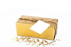 Golden gift box with blank card Royalty Free Stock Image