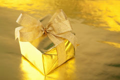 Golden gift box with bow Stock Image