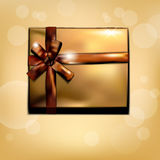 Golden gift box with bow Royalty Free Stock Images