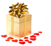 Golden gift box with bow and red hearts Royalty Free Stock Images