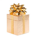 Golden gift box with bow on white Royalty Free Stock Photos