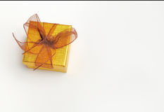Golden gift box with brown tie Top view Royalty Free Stock Photos