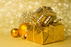 Golden gift box and Christmas balls Stock Images
