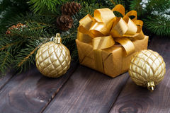 Golden gift box and Christmas balls on the background Stock Photo