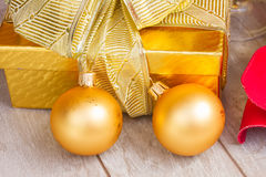 Golden  gift box with christmas decorations Stock Photos