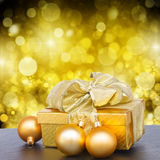 Golden  gift box with christmas decorations Stock Image