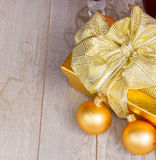 Golden  gift box with christmas decorations Royalty Free Stock Photos