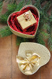 Golden gift box with christmas presents and branch of xmas tree. On wooden background Stock Photography