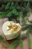 Golden gift box with christmas presents and branch of xmas tree Royalty Free Stock Photo