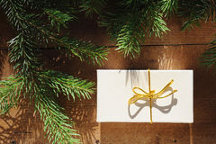 Golden gift box with christmas presents and branch of xmas tree Royalty Free Stock Photography