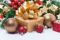 Golden gift box and Christmas tree decorations Stock Photo