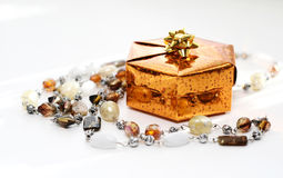Golden gift box with decoration Royalty Free Stock Images