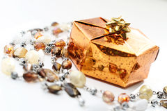 Golden gift box with decoration Stock Photo