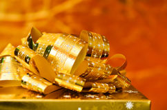 Golden gift box with gold ribbon. Stock Photo