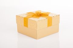 Golden gift box with golden bow on lid Stock Images